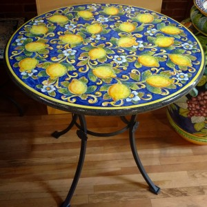 Handmade and hand painted on Sicilian volcanic stone and high-fired like traditional Italian ceramics, these beautiful tables are supremely durable in all weather, indoors and out.