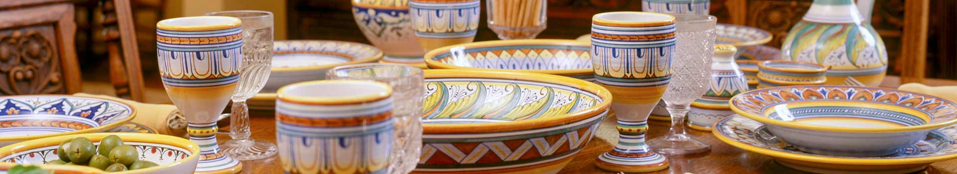 Italian ceramic dishware on the table.