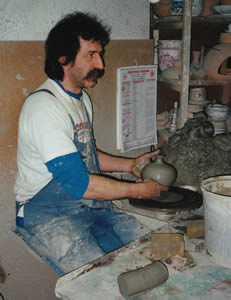 Italian potter throwing a pot