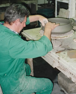 "Italian Potter applying handles with a ""slip"""