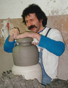 Italian Potter perfecting the shape of the pot