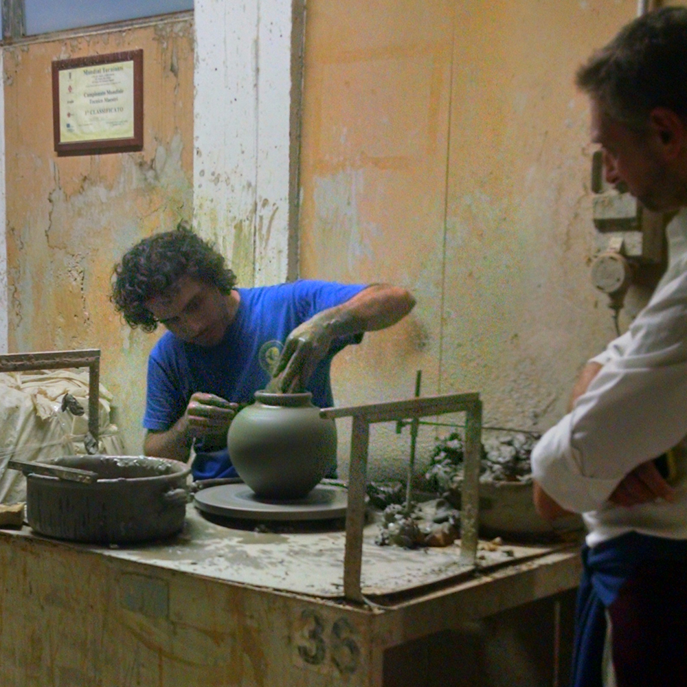 The fastest hands in Italy, turning a pot on a wheel.