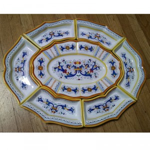 This beautiful, handmade antipastiera is handmade and hand painted in Deruta, Italy.