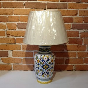 Handmade and hand painted in Deruta, Italy.